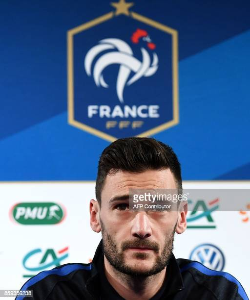 France's goalkeeper Hugo Lloris arrives to give a press conference at the Stade de France stadium in SaintDenis north of Paris on October 9 on the...