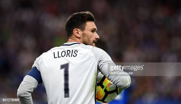 France's goalkeeper Hugo Lloris holds the ball during the 2018 FIFA World Cup qualifying football match France vs Netherlands at the Stade de France...