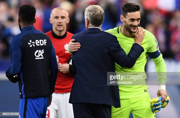 France's goalkeeper Hugo Lloris is congratulated by France's head coach Didier Deschamps at the end during the FIFA World Cup 2018 qualification...