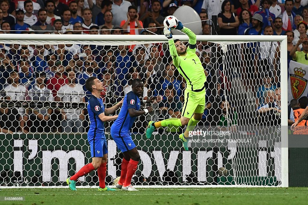 TOPSHOT France's goalkeeper Hugo Lloris jumps for the ball during the Euro 2016 semifinal football match between Germany and France at the Stade...