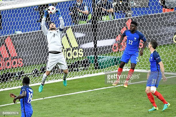 TOPSHOT France's goalkeeper Hugo Lloris jumps for the ball next to France's defender Bacary Sagna France's defender Samuel Umtiti and France's...