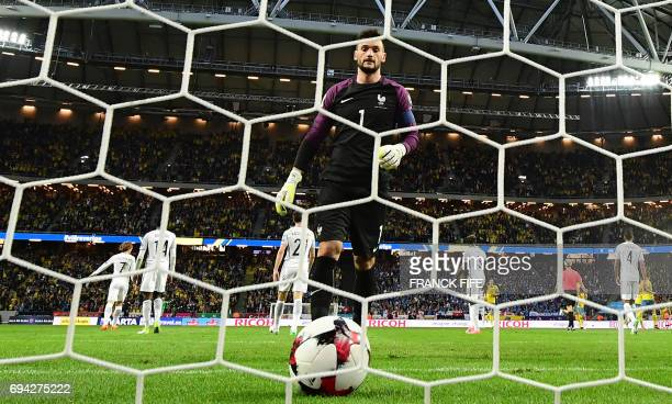 TOPSHOT France's goalkeeper Hugo Lloris picks up the ball after a goal of Sweden during the FIFA World Cup 2018 qualification football match between...