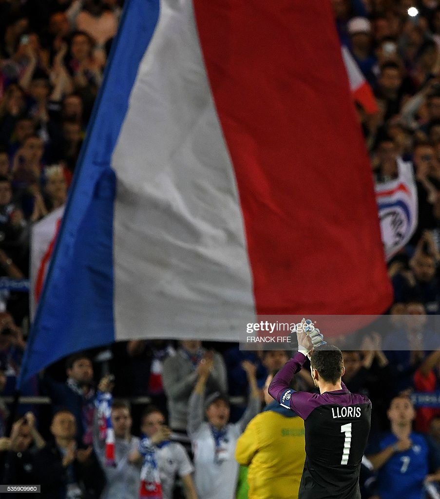 France's goalkeeper Hugo Lloris reacts after winning the friendly football match between France and Cameroon, at the Beaujoire Stadium in Nantes, western France, on May 30, 2016. / AFP / FRANCK