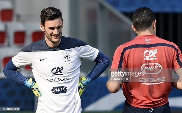France's goalkeeper Hugo Lloris speaks with assistant coach Franck Raviot during a training session on May 31 on the eve of his team's friendly...
