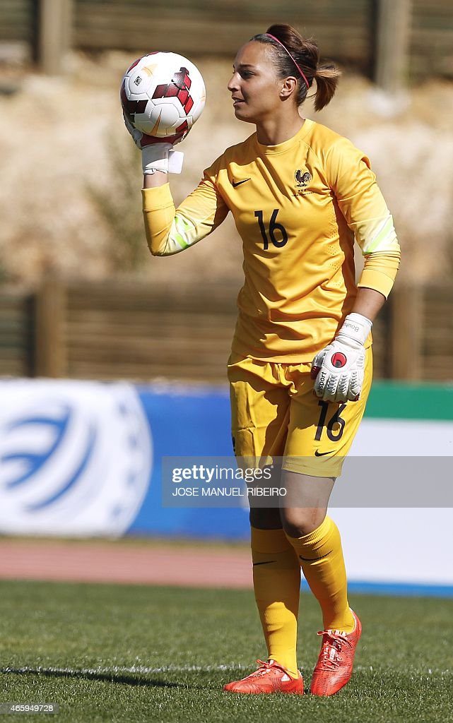 France's goalkeeper <a gi-track='captionPersonalityLinkClicked' href=/galleries/search?phrase=Sarah+Bouhaddi&family=editorial&specificpeople=2351270 ng-click='$event.stopPropagation()'>Sarah Bouhaddi</a> holds the ball during the Algarve Cup football match Japan vs France at the Bela Vista stadium in Parchal on March 9, 2015. AFP PHOTO / JOSE MANUEL RIBEIRO