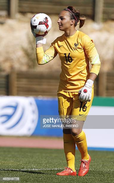 France's goalkeeper Sarah Bouhaddi holds the ball during the Algarve Cup football match Japan vs France at the Bela Vista stadium in Parchal on March...