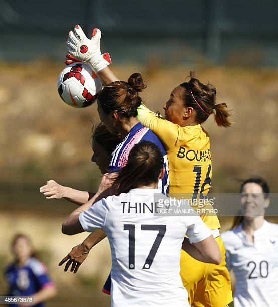 France's goalkeeper Sarah Bouhaddi makes a save beside teammate defender Gaetane Thiney and Japan's forward Yuki Ogimi during the Algarve Cup...