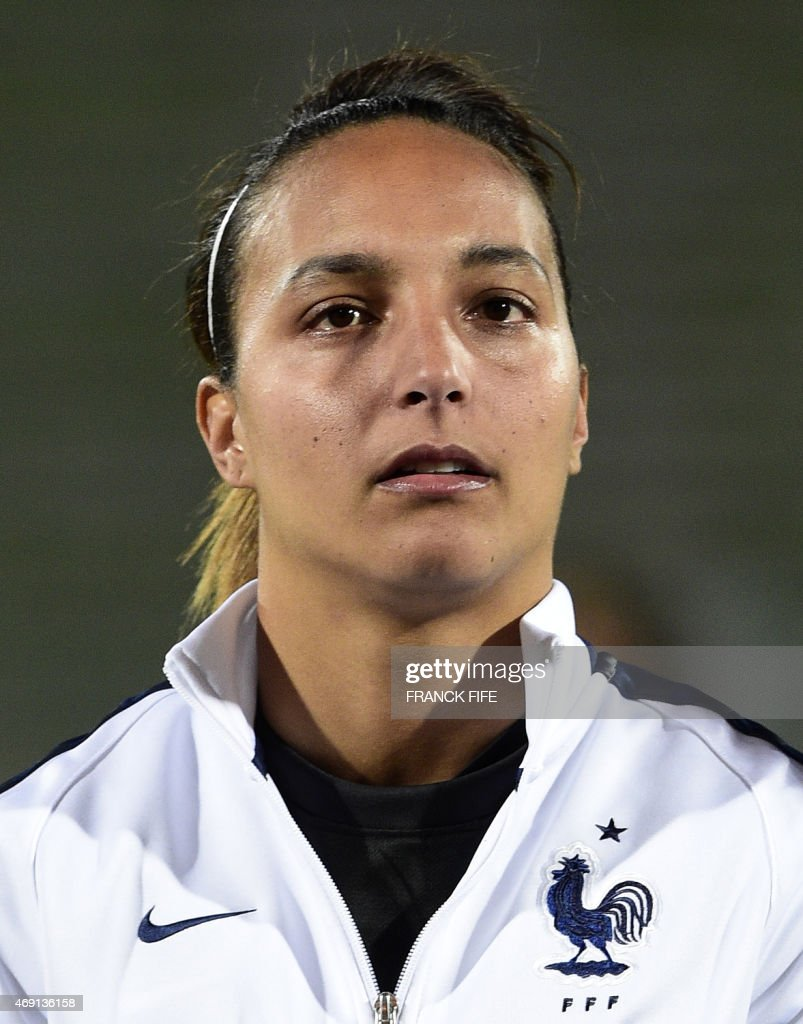 France's goalkeeper Sarah Bouhaddi poses during the French national anthem during the friendly football match France vs Canada, on April 9, 2015 at the Stade Robert-Bobin stadium in Bondoufle, near Paris.
