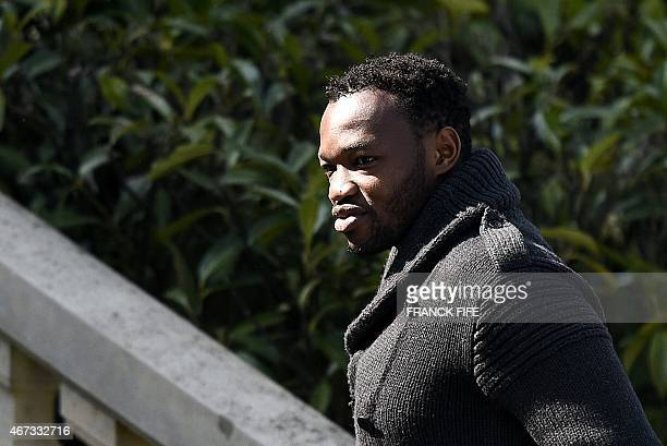 France's goalkeeper Steve Mandanda arrives at the French national football team training base in Clairefontaine on March 23 2015 on the first day of...