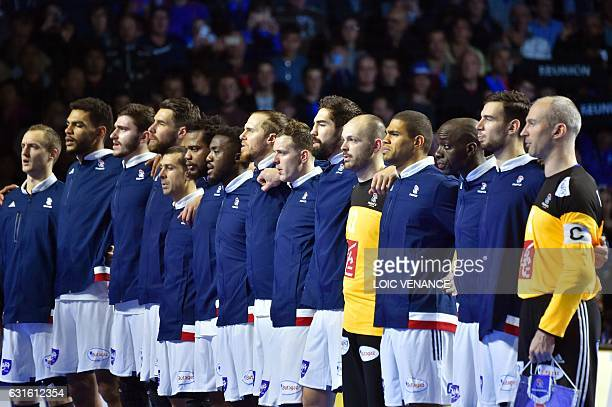 France's goalkeeper Thierry Omeyer France's centre back Daniel Narcisse France's centre back Nikola Karabatic and their teammates stand during the...