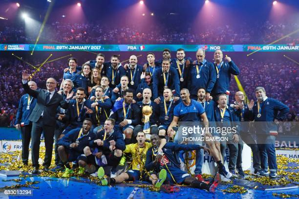 TOPSHOT France's goalkeeper Thierry Omeyer France's head coach Didier Dinart and teammates of France's national handball team and staff pose with the...