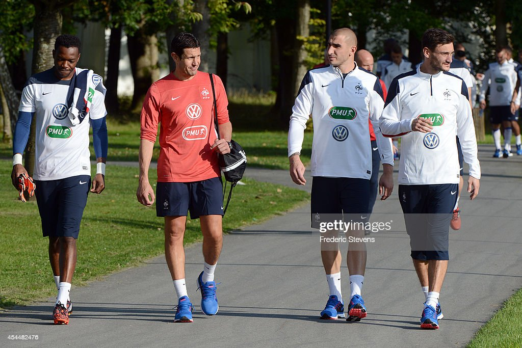 France's goalkeepers team (L-R) <a gi-track='captionPersonalityLinkClicked' href=/galleries/search?phrase=Steve+Mandanda&family=editorial&specificpeople=4470005 ng-click='$event.stopPropagation()'>Steve Mandanda</a>, Franck Raviot (coach for goalkeeper) <a gi-track='captionPersonalityLinkClicked' href=/galleries/search?phrase=Stephane+Ruffier&family=editorial&specificpeople=4978820 ng-click='$event.stopPropagation()'>Stephane Ruffier</a> and <a gi-track='captionPersonalityLinkClicked' href=/galleries/search?phrase=Hugo+Lloris&family=editorial&specificpeople=2501893 ng-click='$event.stopPropagation()'>Hugo Lloris</a> arrive a training session at the French national football team centre in Clairefontaine-en-Yvelines, on September 1, 2014 in Clairefontaine, France.The first day of their training ahead before the friendly football match against Spain team.