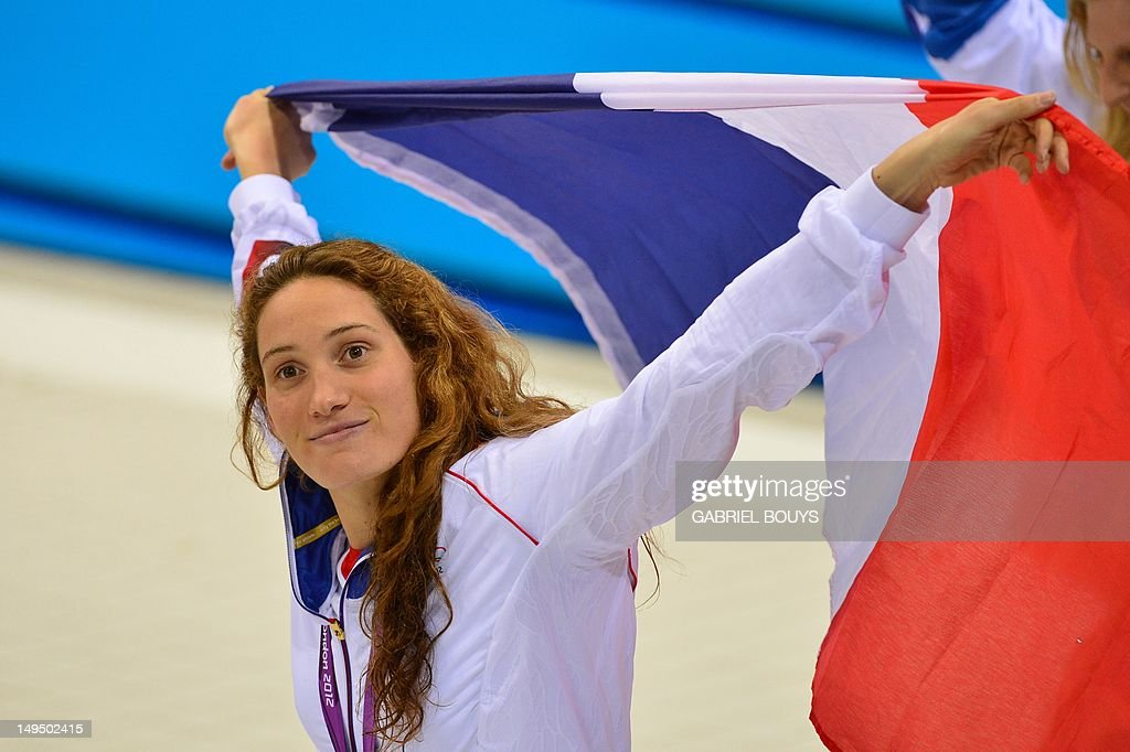 France's gold medalist Camille Muffat celebrates on the podium after the women's 400m freestyle swimming event at the London 2012 Olympic Games on...