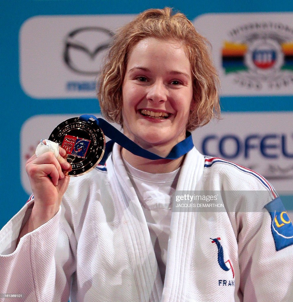 France's gold medalist Lucie Louette celebrates on the podium on February 10, 2013 after winning the Women -78kg category final of the Paris International Judo tournament, part of the Grand Slam, at the Palais Omnisports de Paris-Bercy (POPB) in Paris.