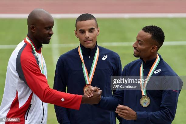 France's gold medallist Loic Herkenrath poses on the podium with Canada's silver medallist Sekou Mohamed Kadou and France's bronze medallist Nicolas...
