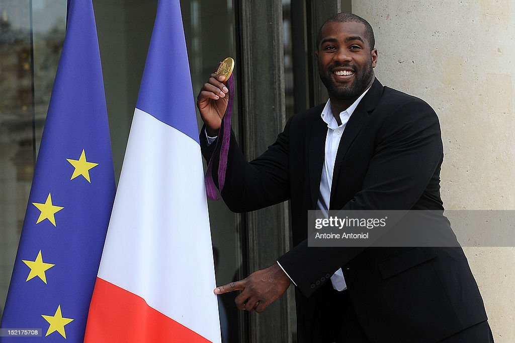 France's Gold Olympic judo athlete <a gi-track='captionPersonalityLinkClicked' href=/galleries/search?phrase=Teddy+Riner&family=editorial&specificpeople=4114927 ng-click='$event.stopPropagation()'>Teddy Riner</a> arrives for a ceremony with France's President Francois Hollande at Elysee Palace on September 17, 2012 in Paris, France.