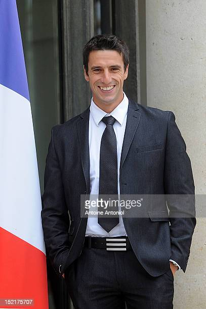 France's Gold Olympic kayak athlete Tony Estanguet arrives for a ceremony with France's President Francois Hollande at Elysee Palace on September 17...