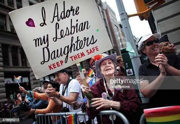 Frances Goldin who has two lesbian daughters holds a sign while watching the Gay Pride Parade on June 28 2015 in New York City The parade is being...