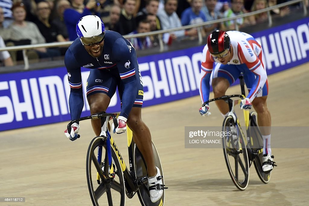 France's <a gi-track='captionPersonalityLinkClicked' href=/galleries/search?phrase=Gregory+Bauge&family=editorial&specificpeople=217259 ng-click='$event.stopPropagation()'>Gregory Bauge</a> (L) reacts after crossing the finish line ahead of Russia's <a gi-track='captionPersonalityLinkClicked' href=/galleries/search?phrase=Denis+Dmitriev&family=editorial&specificpeople=5492378 ng-click='$event.stopPropagation()'>Denis Dmitriev</a> in the Men's Sprint finals at the UCI Track Cycling World Championships in Saint-Quentin-en-Yvelines, near Paris, on February 22, 2015.