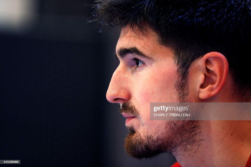 France's guard Nando de Colo looks on during a press conference on June 27, 2016 in Rouen, northwestern France a day before the basketball match between France and Japan. / AFP / CHARLY