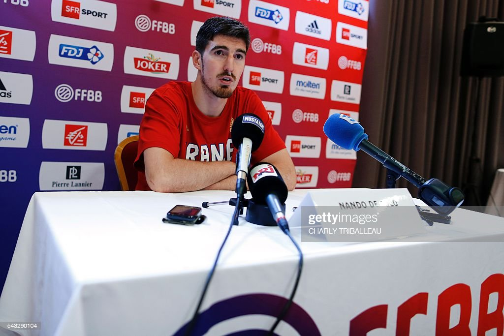 France's guard Nando de Colo speaks during a press conference on June 27, 2016 in Rouen, northwestern France a day before the basketball match between France and Japan. / AFP / CHARLY