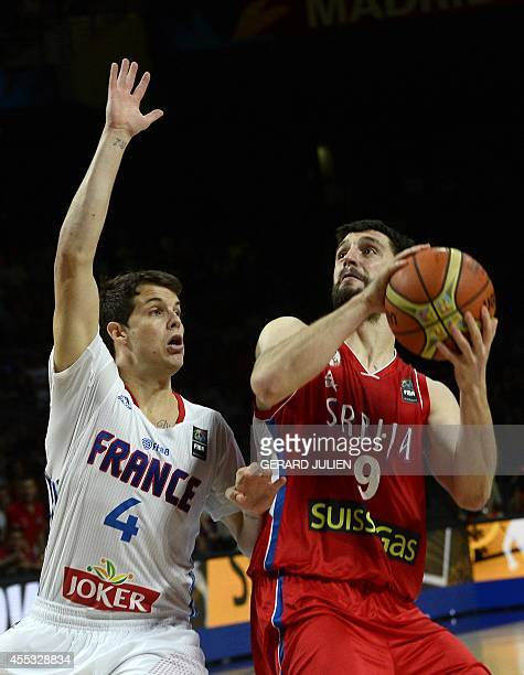 France's guard Thomas Heurtel vies with Serbia's guard Stefan Markovic during the 2014 FIBA World basketball championships semifinal match France vs...