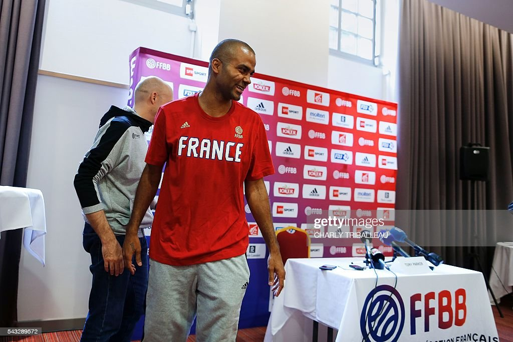 France's guard Tony Parker leaves the room after giving a press conference on June 27, 2016 in Rouen, northwestern France a day before the basketball match between France and Japan. / AFP / CHARLY