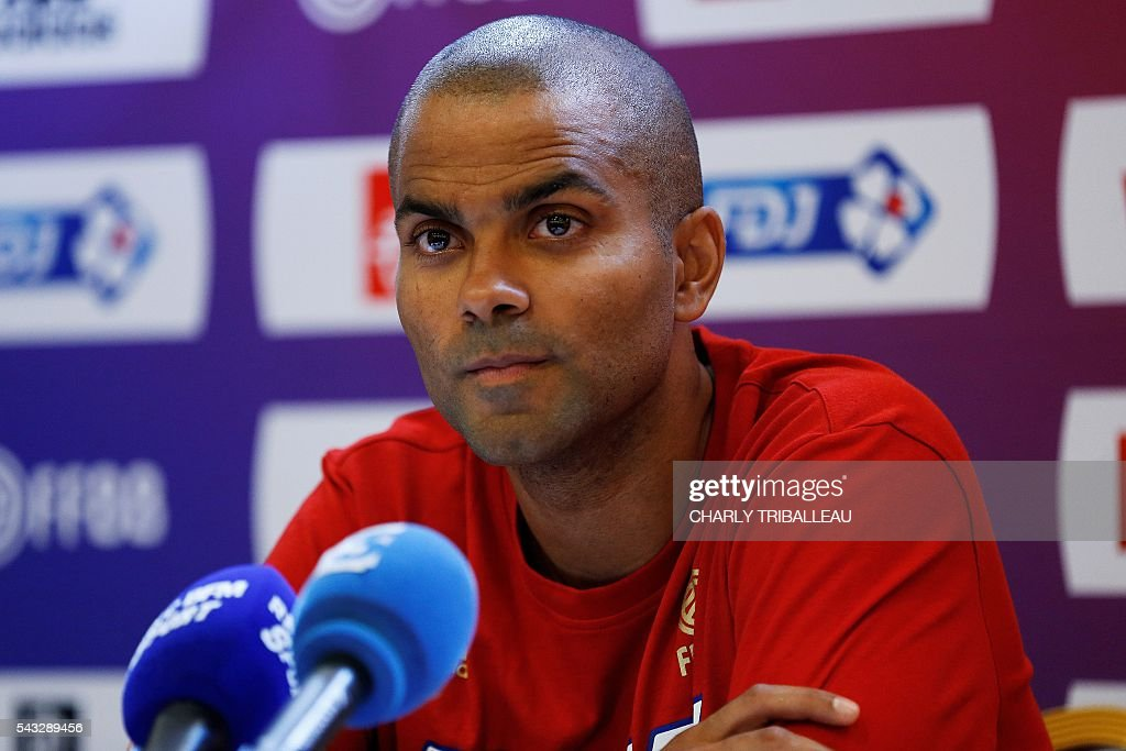 France's guard Tony Parker looks on during a press conference on June 27, 2016 in Rouen, northwestern France a day before the basketball match between France and Japan. / AFP / CHARLY