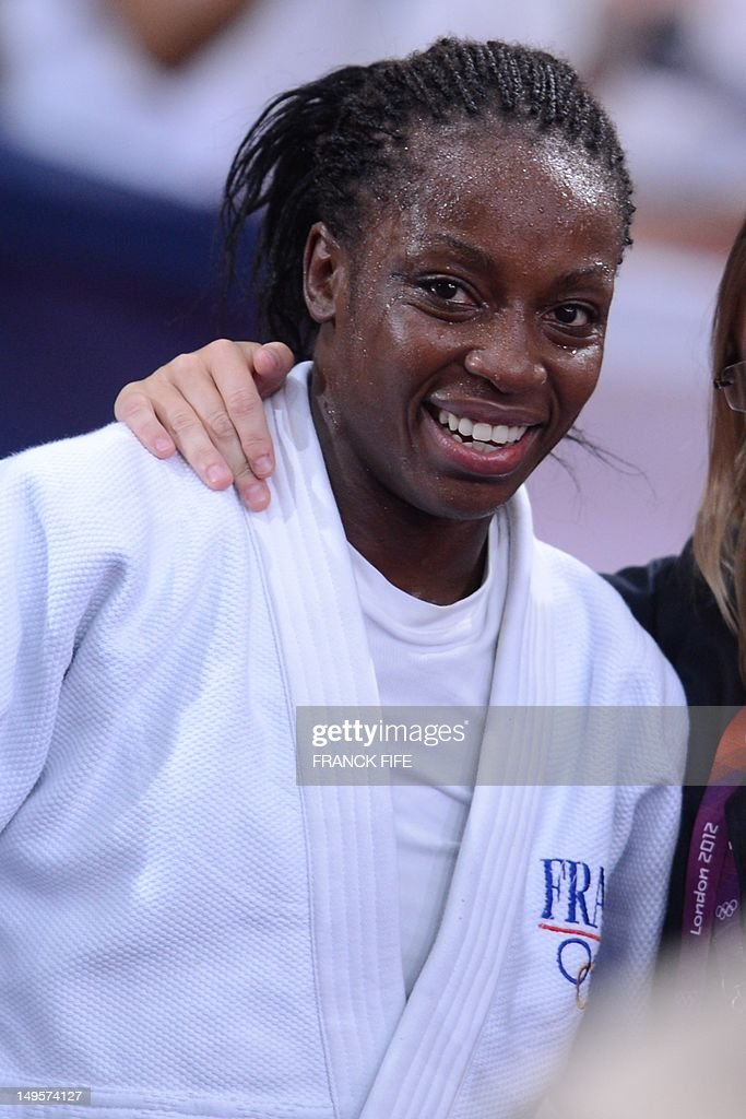 France's Gévrise Emane reacts after winning against Korea's Joung Da-Woon (blue) during their women's -63kg judo contest bronze medal match of the London 2012 Olympic Games on July 31, 2012 ExCel arena in London.