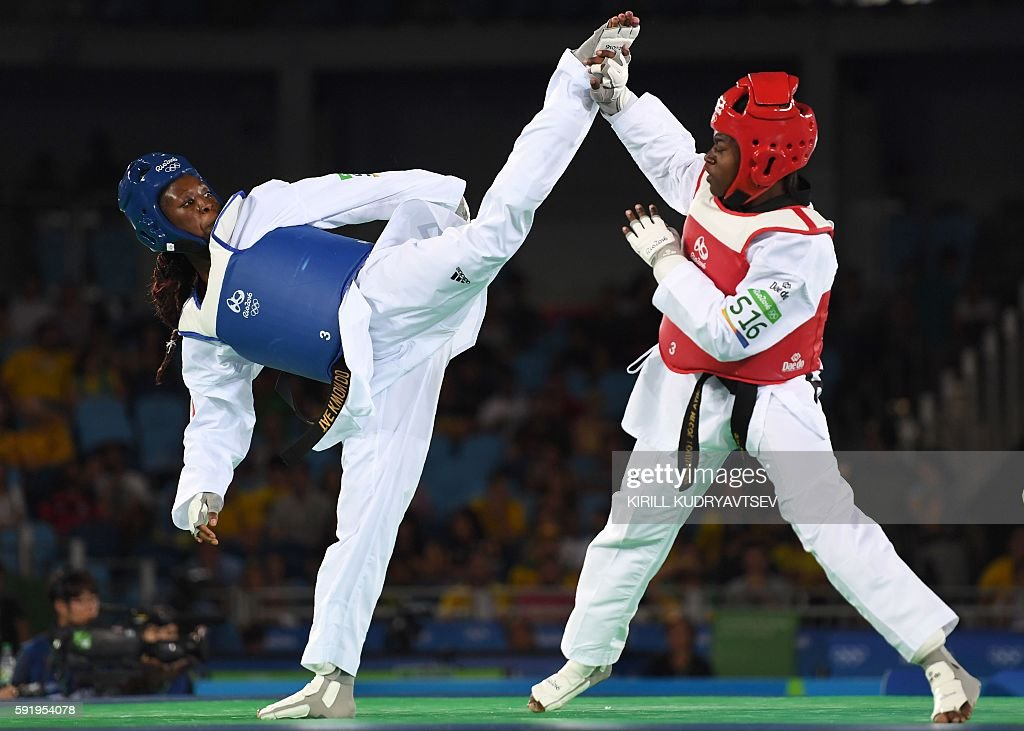 France's Haby Niare (L) competes against Haiti's Aniya Necol Louissaint during their womens taekwondo qualifying bout in the -67kg category as part of the Rio 2016 Olympic Games, on August 19, 2016, at the Carioca Arena 3, in Rio de Janeiro. / AFP / Kirill KUDRYAVTSEV