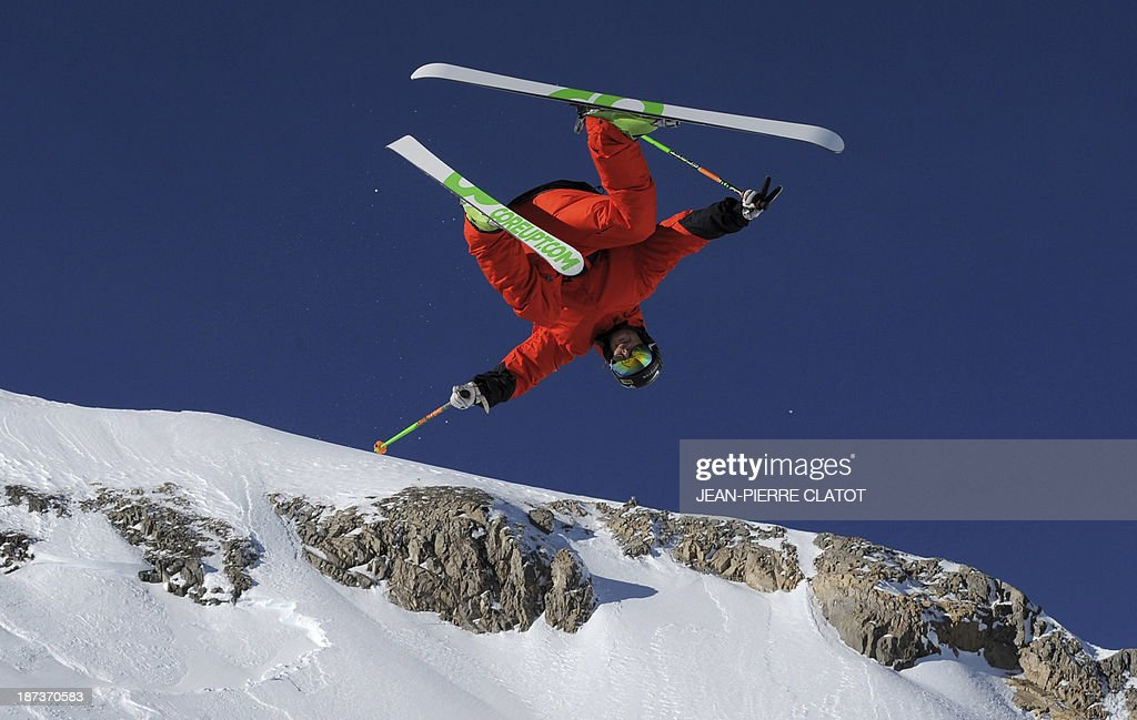 France's halfpipe skier Kevin Rolland trains during a practice session in Tignes on November 8, 2013 ahead of the 2014 Winter Olympics in Sochi. AFP PHOTO /JEAN-PIERRE CLATOT