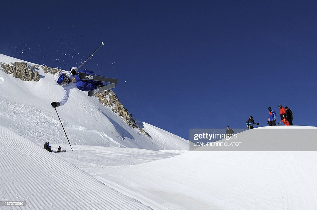 France's halfpipe skier Marie Martinod trains during a practice session in Tignes on November 8, 2013 ahead of the 2014 Winter Olympics in Sochi. AFP PHOTO /JEAN-PIERRE CLATOT