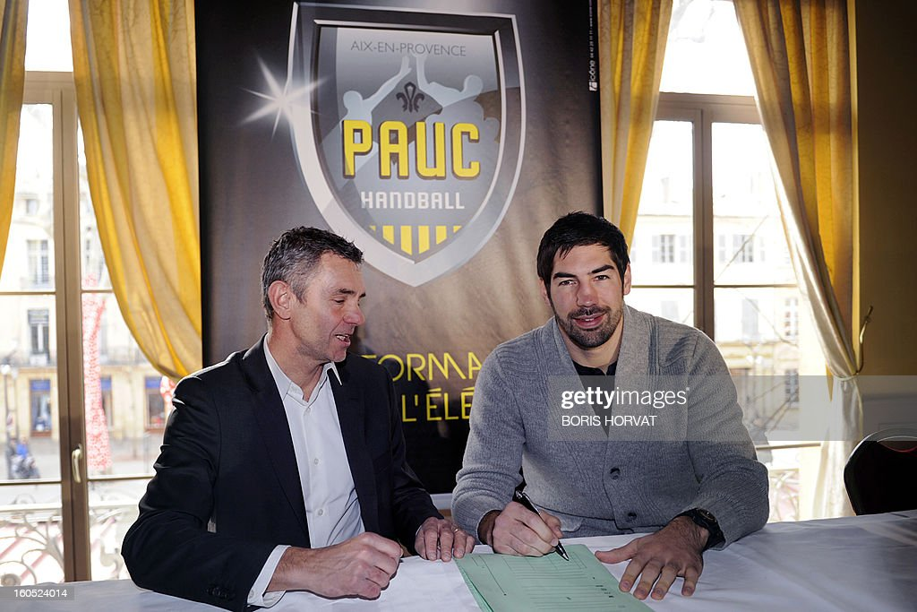 France's handball player Nikola Karabatic (R) is about to sign his contract with the handball club of Aix-en-Provence (PAUC), next to the PAUC President Christian Salonnez (L) during a press conference on February 2, 2013 in Aix-en-Provence, southern France. AFP PHOTO / BORIS HORVAT