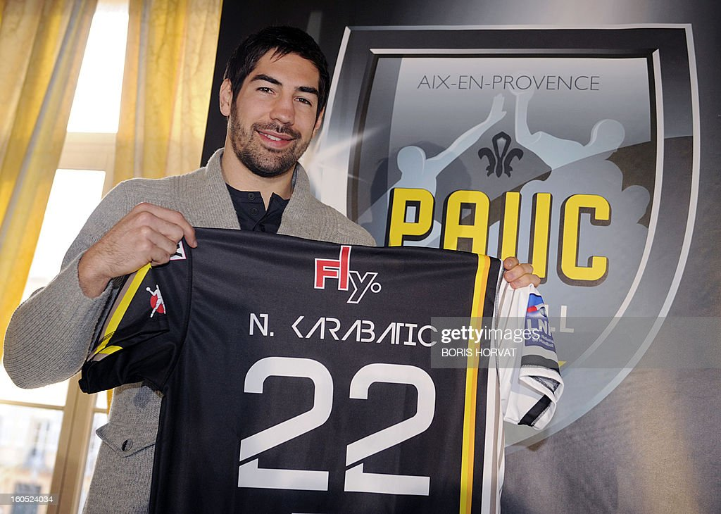 France's handball player Nikola Karabatic poses with his new jersey after he signed a contract with the handball club of Aix-en-Provence (PAUC) on February 2, 2013 in Aix-en-Provence, southern France. AFP PHOTO / BORIS HORVAT