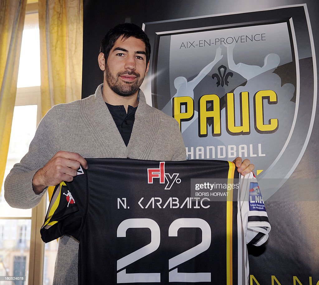 France's handball player Nikola Karabatic poses with his new jersey after he signed a contract with the handball club of Aix-en-Provence (PAUC) on February 2, 2013 in Aix-en-Provence, southern France.
