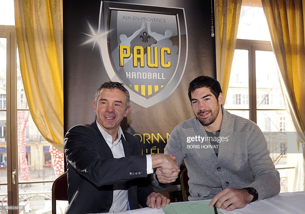 France's handball player Nikola Karabatic (R) shakes hands with handball club of Aix-en-Provence (PAUC) President Christian Salonnez, after he signed his contract with the PAUC, during a press conference on February 2, 2013 in Aix-en-Provence, southern France. AFP PHOTO / BORIS HORVAT