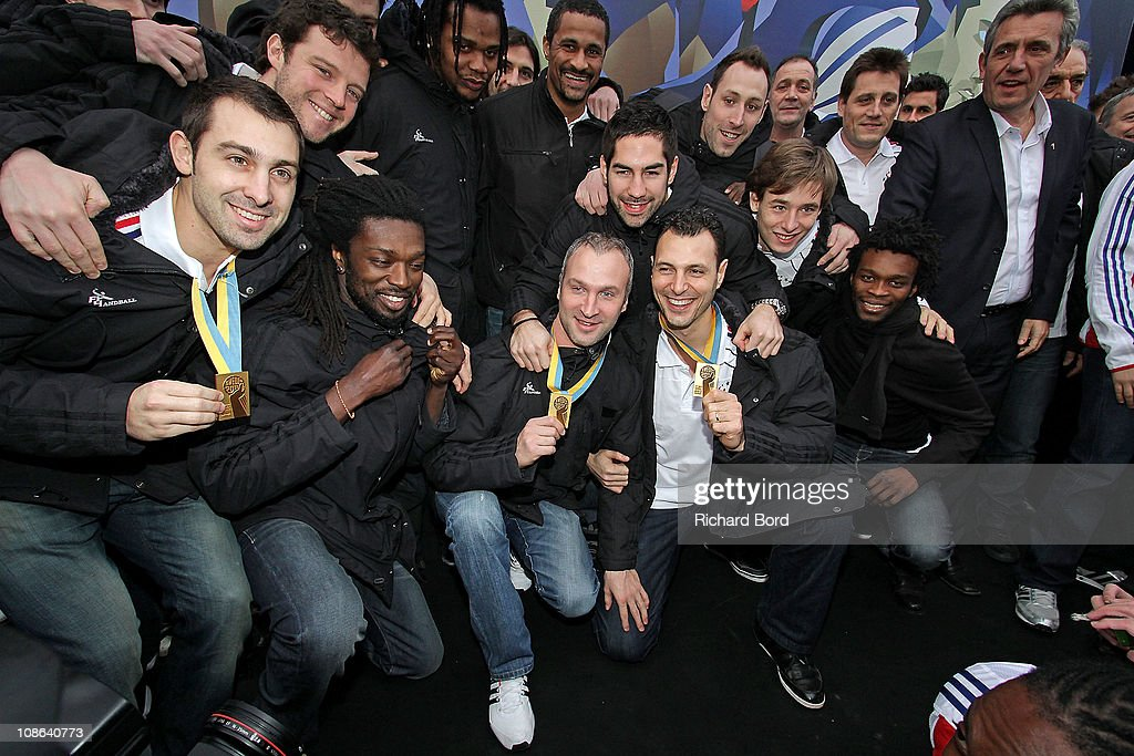 France's Handball Players Samuel Honrubia, <a gi-track='captionPersonalityLinkClicked' href=/galleries/search?phrase=Michael+Guigou&family=editorial&specificpeople=791016 ng-click='$event.stopPropagation()'>Michael Guigou</a>, Guillaume Joli, <a gi-track='captionPersonalityLinkClicked' href=/galleries/search?phrase=Daouda+Karaboue&family=editorial&specificpeople=853768 ng-click='$event.stopPropagation()'>Daouda Karaboue</a>, Cedric Sorhaindo, <a gi-track='captionPersonalityLinkClicked' href=/galleries/search?phrase=Didier+Dinart&family=editorial&specificpeople=710241 ng-click='$event.stopPropagation()'>Didier Dinart</a>, <a gi-track='captionPersonalityLinkClicked' href=/galleries/search?phrase=Thierry+Omeyer&family=editorial&specificpeople=853674 ng-click='$event.stopPropagation()'>Thierry Omeyer</a>, Nikola Karibatic, <a gi-track='captionPersonalityLinkClicked' href=/galleries/search?phrase=Jerome+Fernandez&family=editorial&specificpeople=791049 ng-click='$event.stopPropagation()'>Jerome Fernandez</a>, Bertrand Roine, Xavier Barachet, Arnaud Bingo and coach <a gi-track='captionPersonalityLinkClicked' href=/galleries/search?phrase=Claude+Onesta&family=editorial&specificpeople=792495 ng-click='$event.stopPropagation()'>Claude Onesta</a> pose for media as they celebrate their World Cup victory on Champs-Elysees January 31, 2011 in Paris, France.