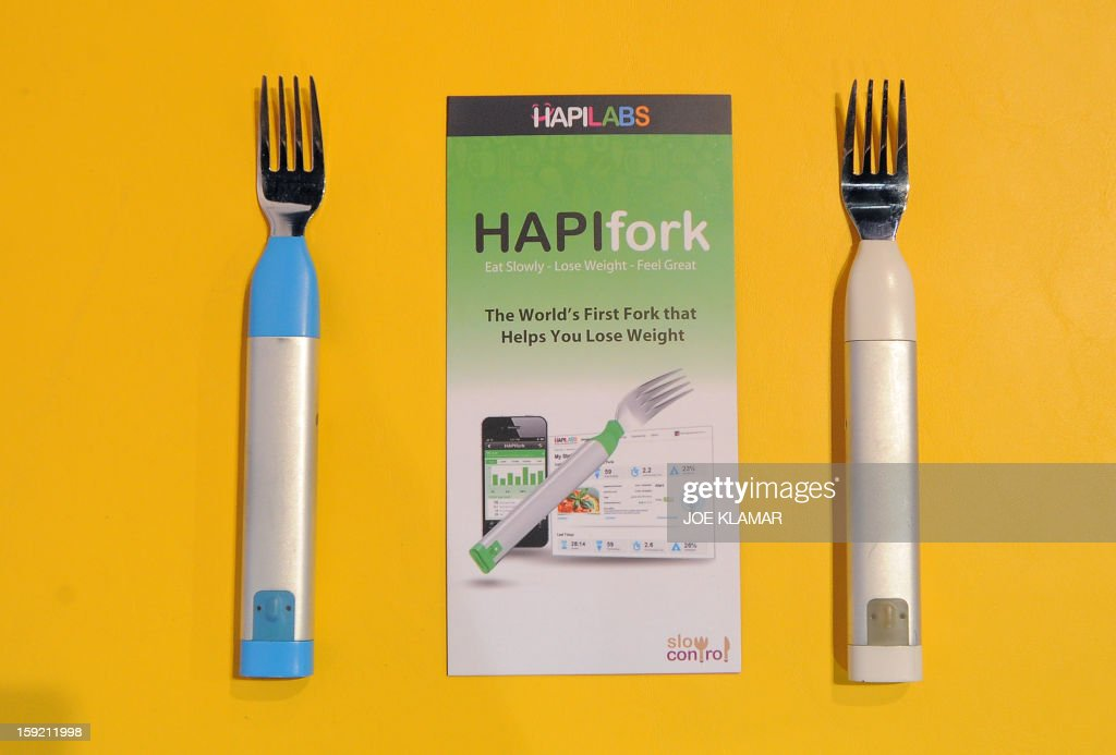 France's Hapilabs displays wireless computer connected forks ,controlling appetite and collecting dining informations ,at the 2013 International CES at the Las Vegas Convention Center on January 9, 2013 in Las Vegas, Nevada. CES, the world's largest annual consumer technology trade show, runs from January 8-11 and is expected to feature 3,100 exhibitors showing off their latest products and services to about 150,000 attendees.AFP PHOTO / JOE KLAMAR