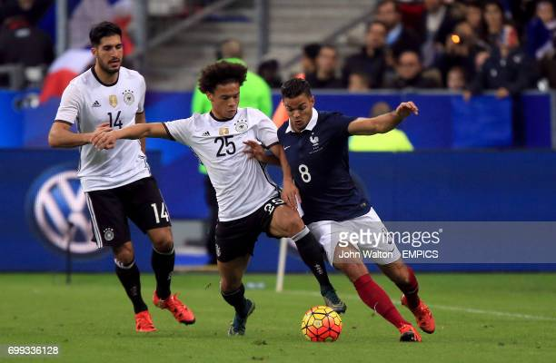 France's Hatem Ben Arfa and Germany's Leroy Sane battle for the ball