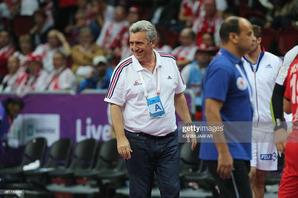 France's head coach <a gi-track='captionPersonalityLinkClicked' href=/galleries/search?phrase=Claude+Onesta&family=editorial&specificpeople=792495 ng-click='$event.stopPropagation()'>Claude Onesta</a> smiles during the 24th Men's Handball World Championships preliminary round Group C match between France and Egypt at the Duhail Handball Sports Hall in the Qatari capital Doha on January 18, 2015.