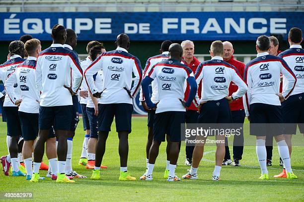 France's head coach Didier Deschamps and assistant coach Guy Stephan give instructions to the players during a training session at the French...