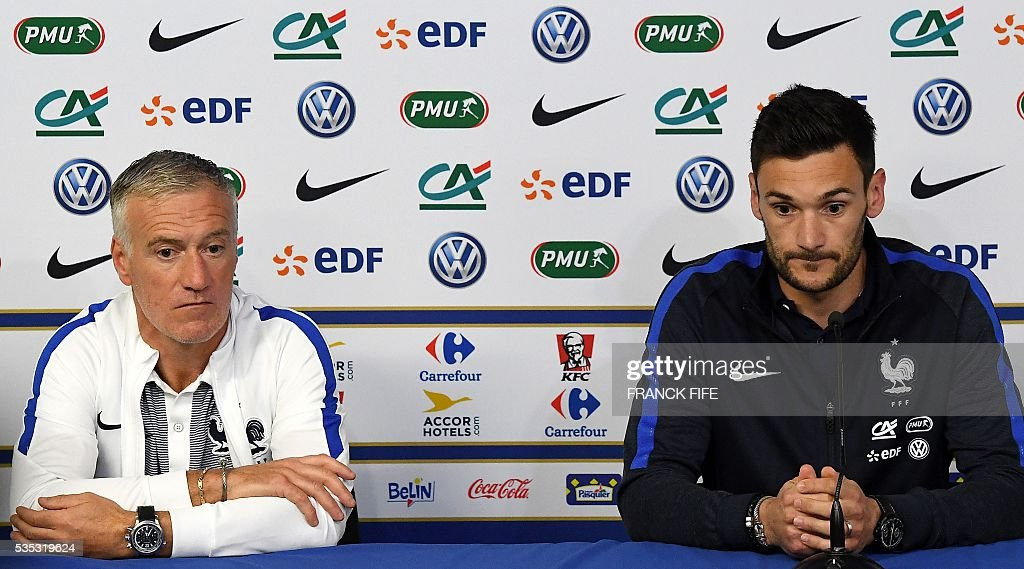 France's head coach Didier Deschamps (L) and France's goalkeeper Hugo Lloris look on during a press conference at the Beaujoire Stadium in Nantes, western France, on May 29, 2016, on the eve of the friendly football match France versus Cameroun as part of the team's preparation for the upcoming Euro 2016 European football championships. / AFP / FRANCK