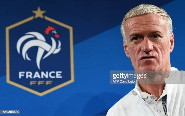 France's head coach Didier Deschamps arrives for a press conference at the Stade de France stadium in SaintDenis north of Paris on October 9 on the...