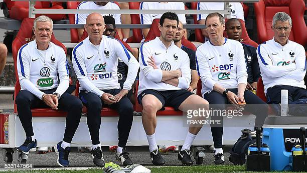 France's head coach Didier Deschamps assistant coach Guy Stephan goalkeeper coach Franck Raviot French fitness coach Eric Bedouet watch France...