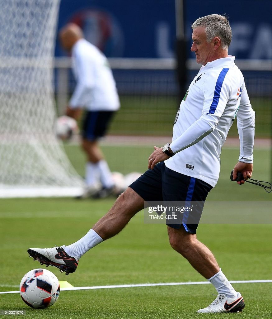 France's head coach Didier Deschamps controls the ball during a training session in Clairefontaine-en-Yvelines, southwest of Paris, on June 6, 2016, during the Euro 2016 football tournament. / AFP / FRANCK