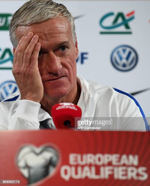 France's head coach Didier Deschamps gestures as he gives a press conference at the Stade de France stadium in SaintDenis north of Paris on October 9...