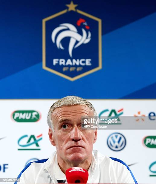 France's head coach Didier Deschamps gives a press conference at the Stade de France stadium in SaintDenis north of Paris on October 9 on the eve of...