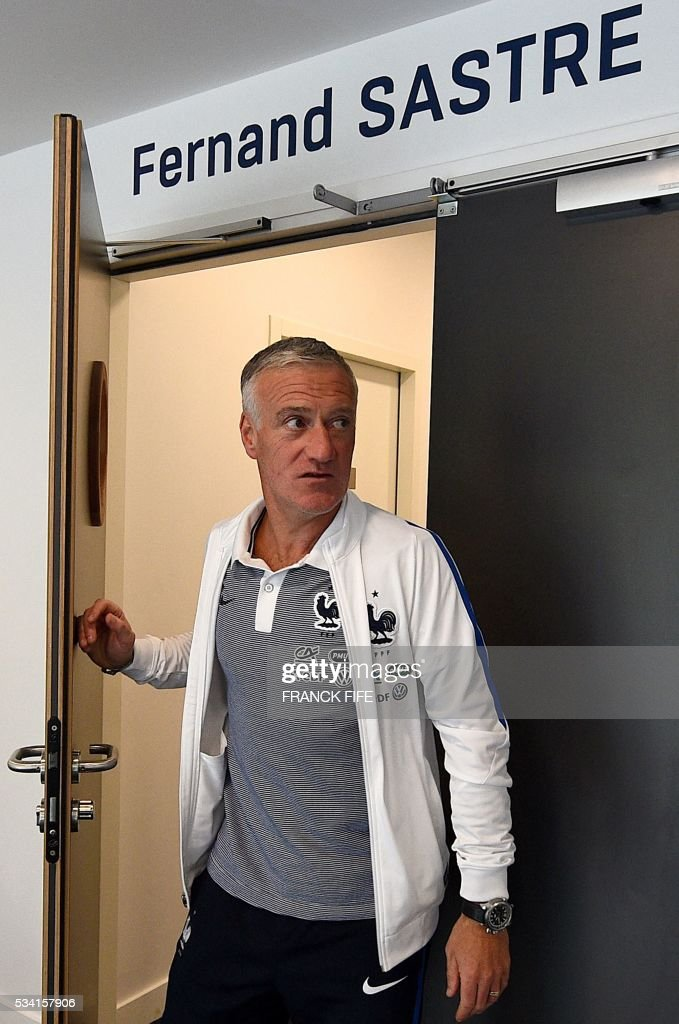 France's head coach Didier Deschamps leaves a press conference in Clairefontaine on May 25, 2016, as part of the team's preparation for the upcoming Euro 2016 European football championships. FIFE