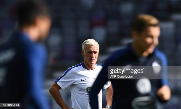 France's head coach Didier Deschamps looks at his players during a training session at the Municipal Stadium in Toulouse southern France on September...
