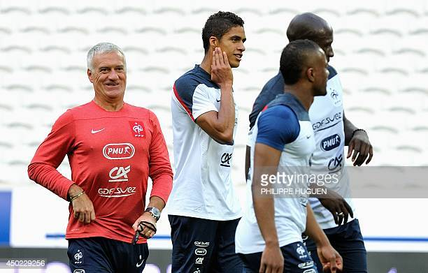 France's head coach Didier Deschamps reacts during a training session at the Pierre Mauroy stadium in Villeneuve d'Ascq northern France on June 7...